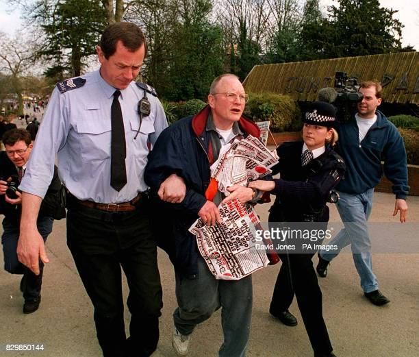 Tony Samuelson a candidate for the Daily Loonylugs party in the SE Staff by election is led away by police after he intercepted Cabinet Minister...