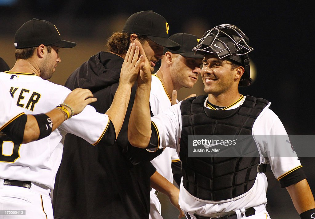 Tony Sanchez #59 of the Pittsburgh Pirates celebrates after winning his first game starting in Major Leagues during game two of a doubleheader against the St. Louis Cardinals on July 30, 2013 at PNC Park in Pittsburgh, Pennsylvania. The Pirates defeated the Cardinals 6-0.