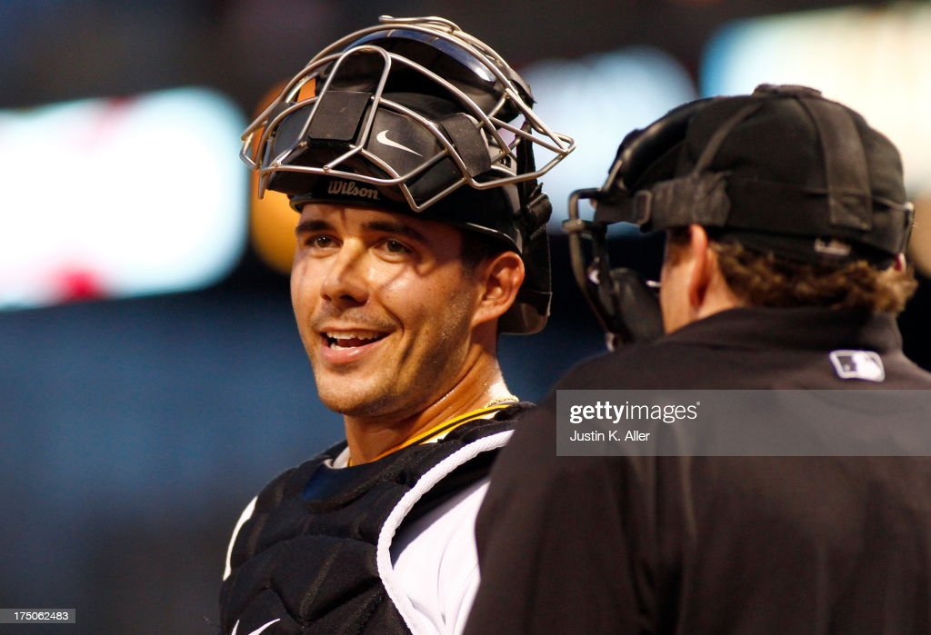 Tony Sanchez #59 of the Pittsburgh Pirates chats with the home plate umpire before game two of a doubleheader against the St Louis Cardinals on July 30, 2013 at PNC Park in Pittsburgh, Pennsylvania.
