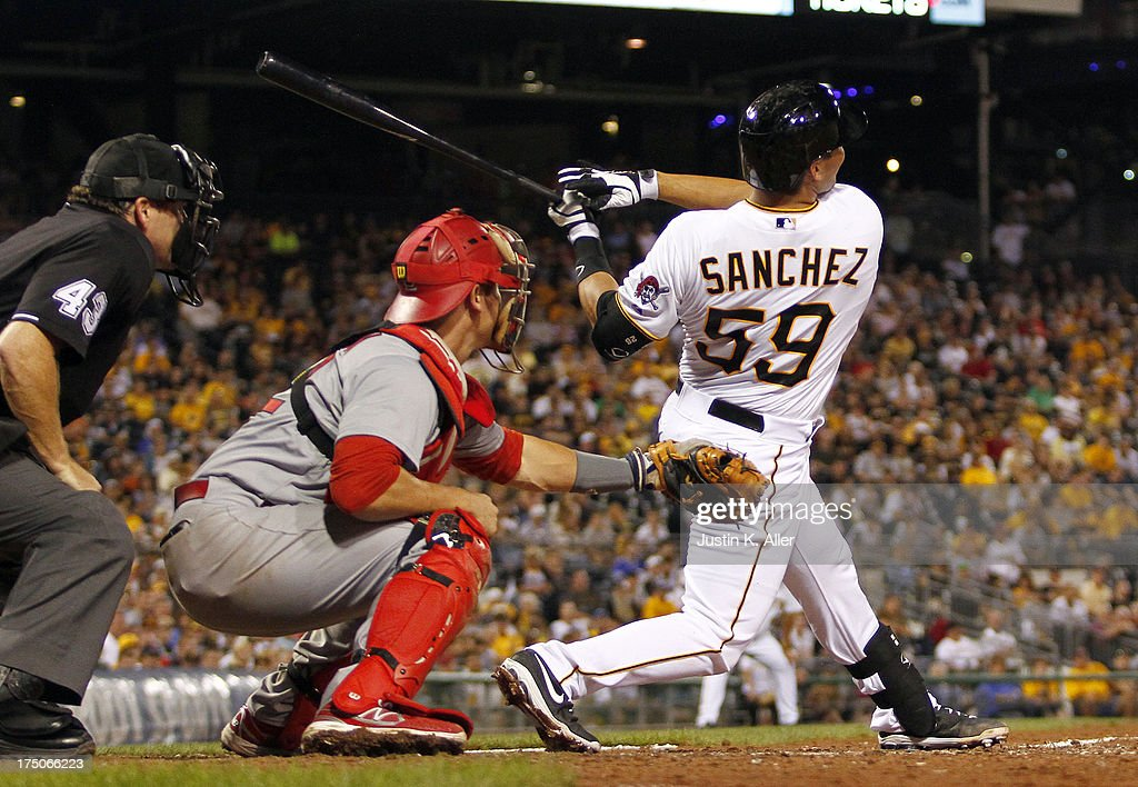 Tony Sanchez #59 of the Pittsburgh Pirates hits a sacrifice fly in the seventh inning against the St. Louis Cardinals during game two of a doubleheader on July 30, 2013 at PNC Park in Pittsburgh, Pennsylvania.