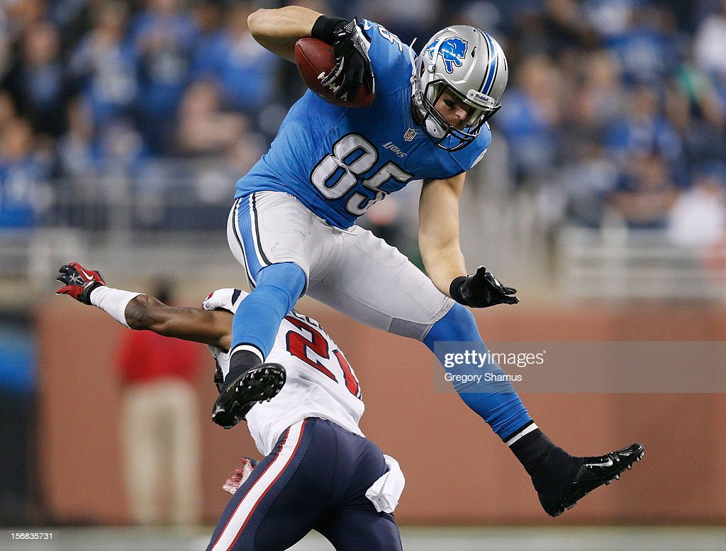 <a gi-track='captionPersonalityLinkClicked' href=/galleries/search?phrase=Tony+Scheffler&family=editorial&specificpeople=712630 ng-click='$event.stopPropagation()'>Tony Scheffler</a> #85 of the Detroit Lions jumps over Brice McCain #21 of the Houston Texans after a overtime catch at Ford Field on November 22, 2012 in Detroit, Michigan. Houston won the game 34-31.