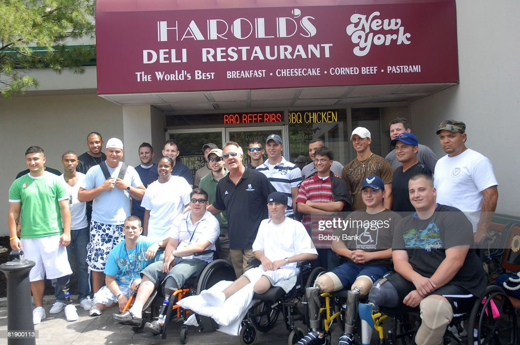 Tony Sirico of the Sopranos with Soldiers of the Wounded Warrior Project attends the Wounded Warrior Soldiers Project luncheon at Harold's Deli on July 10, 2008 in Edison, New Jersey.