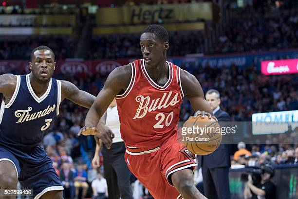 Tony Snell of the Chicago Bulls brings the ball up court against the Oklahoma City Thunder during the first quarter of a NBA game at the Chesapeake...