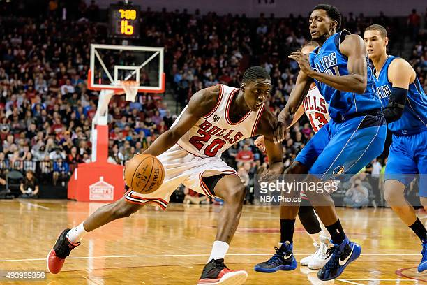 Tony Snell of the Chicago Bulls handles the ball against the Dallas Mavericks on October 23 2015 at Pinnacle Bank Arena in Lincoln Nebraska NOTE TO...