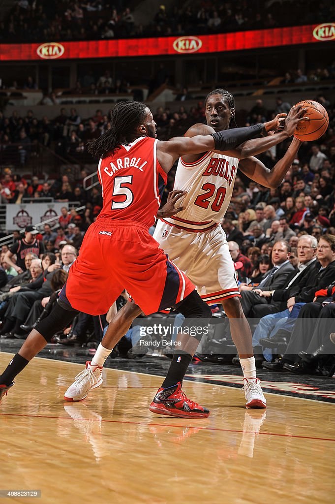 <a gi-track='captionPersonalityLinkClicked' href=/galleries/search?phrase=Tony+Snell&family=editorial&specificpeople=7551553 ng-click='$event.stopPropagation()'>Tony Snell</a> #20 of the Chicago Bulls is guarded by <a gi-track='captionPersonalityLinkClicked' href=/galleries/search?phrase=DeMarre+Carroll&family=editorial&specificpeople=784686 ng-click='$event.stopPropagation()'>DeMarre Carroll</a> #5 of the Atlanta Hawks on February 11, 2013 at the United Center in Chicago, Illinois.