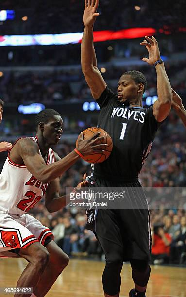 Tony Snell of the Chicago Bulls moves against Glenn Robinson III of the Minnesota Timberwolves at the United Center on February 27 2015 in Chicago...