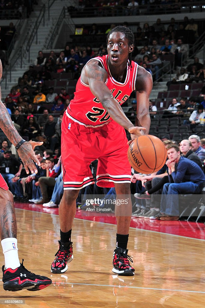 <a gi-track='captionPersonalityLinkClicked' href=/galleries/search?phrase=Tony+Snell&family=editorial&specificpeople=7551553 ng-click='$event.stopPropagation()'>Tony Snell</a> #20 of the Chicago Bulls passes the ball against the Detroit Pistons on November 27, 2013 at The Palace of Auburn Hills in Auburn Hills, Michigan.