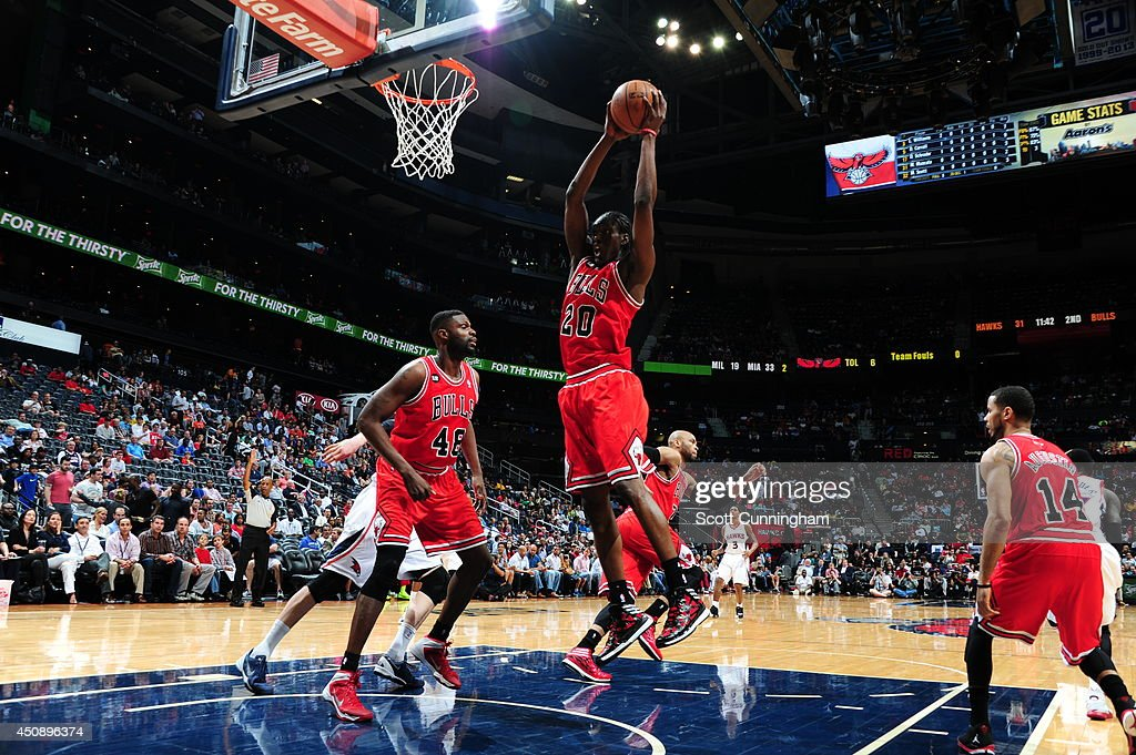 <a gi-track='captionPersonalityLinkClicked' href=/galleries/search?phrase=Tony+Snell&family=editorial&specificpeople=7551553 ng-click='$event.stopPropagation()'>Tony Snell</a> #20 of the Chicago Bulls rebounds against the Atlanta Hawks on April 2, 2014 at Philips Arena in Atlanta, Georgia.