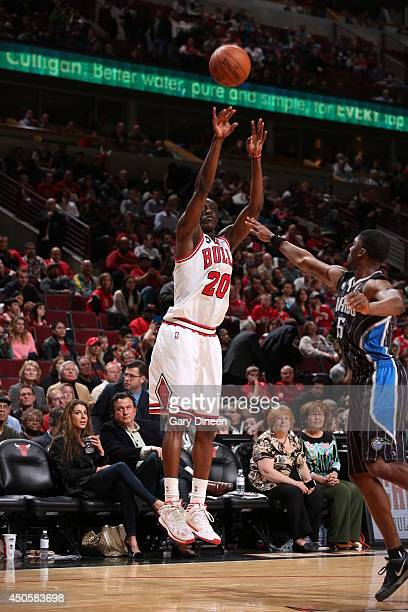 Tony Snell of the Chicago Bulls shoots against the Orlando Magic on April 14 2014 at the United Center in Chicago Illinois NOTE TO USER User...