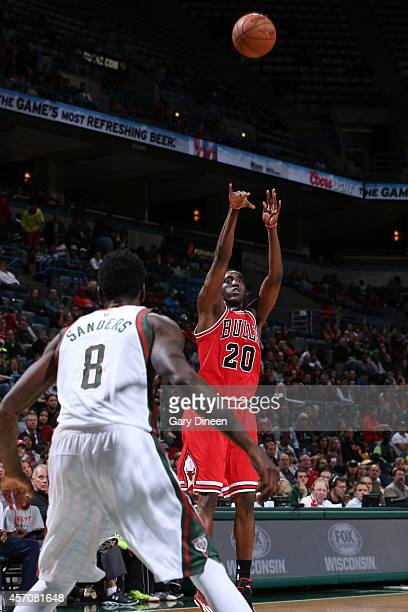 Tony Snell of the Chicago Bulls shoots the ball against Larry Sanders of the Milwaukee Bucks during the game on October 11 2014 at BMO Harris Bradley...