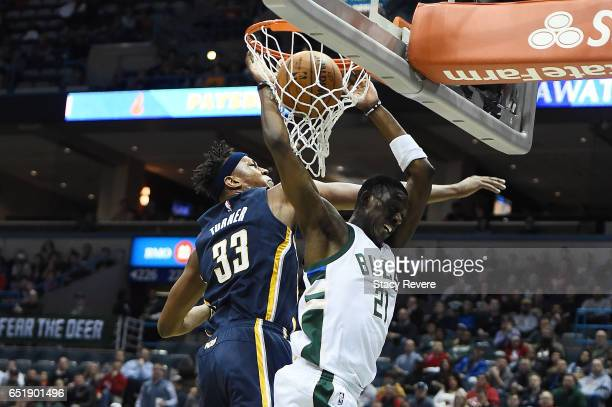 Tony Snell of the Milwaukee Bucks dunks in front of Myles Turner of the Indiana Pacers during the first half of a game at the BMO Harris Bradley...
