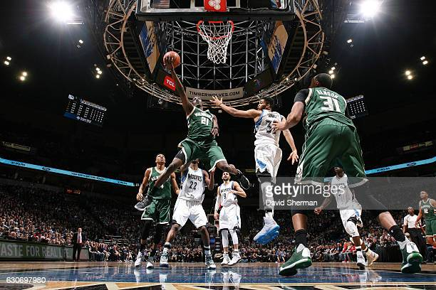 Tony Snell of the Milwaukee Bucks goes for the lay up during the game against the Minnesota Timberwolves on December 30 2016 at Target Center in...