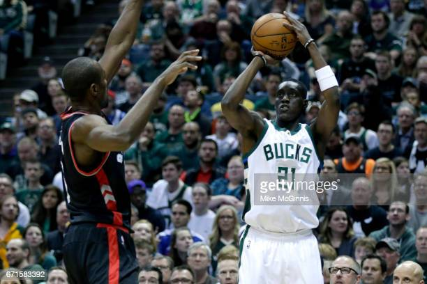 Tony Snell of the Milwaukee Bucks shoots a two pointer with Serge Ibaka of the Toronto Raptors defending during the first half of Game Four of the...