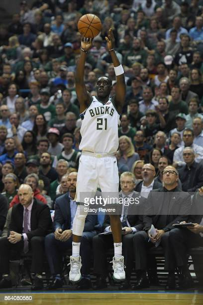 Tony Snell of the Milwaukee Bucks takes a three point shot against the Cleveland Cavaliers during the first quarter of a game at the Bradley Center...