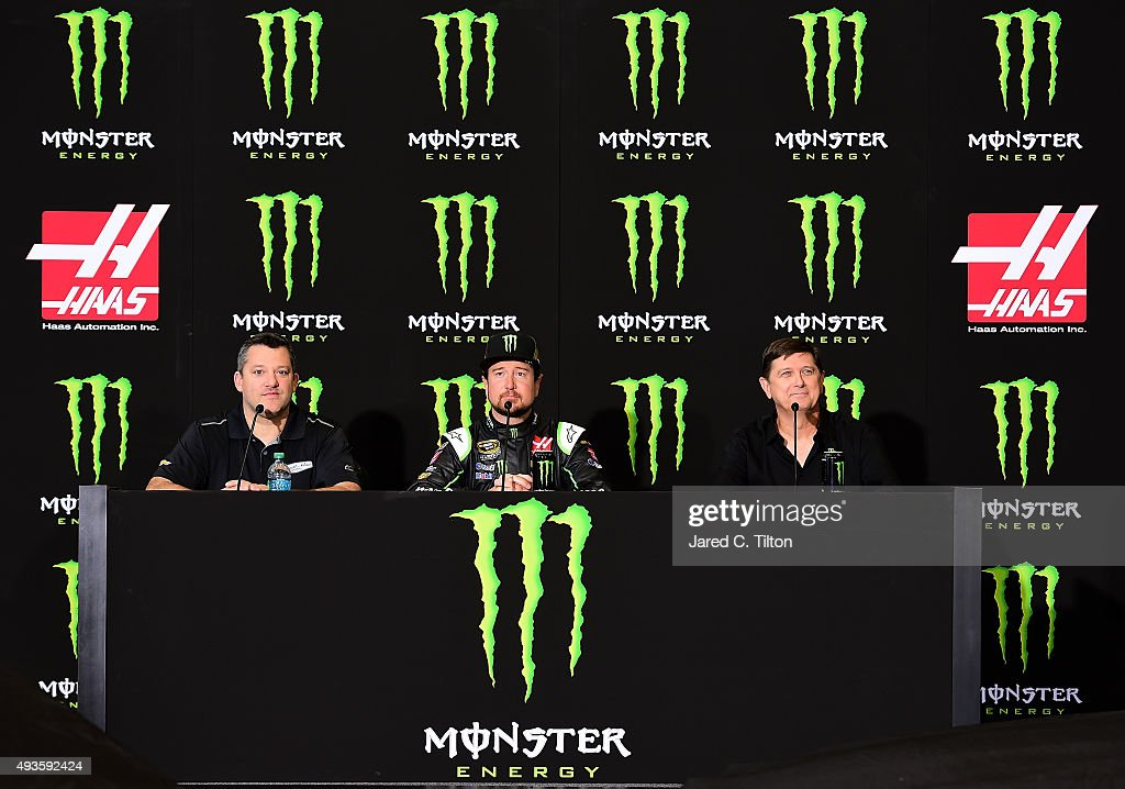 Tony Stewart coowner of StewartHaas Racing speaks with the media as Kurt Busch driver of the StewartHaas Racing Chevrolet and Mitch Covington vice...