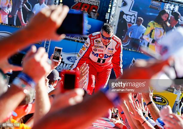 Tony Stewart driver of the Always a Racer/Mobil 1 Chevrolet greets fans as he is introduced prior to the NASCAR Sprint Cup Series Ford EcoBoost 400...