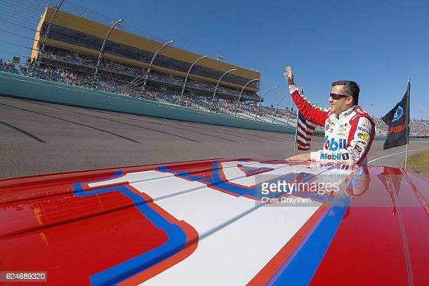 Tony Stewart driver of the Always a Racer/Mobil 1 Chevrolet waves to the fans prior to the start of the NASCAR Sprint Cup Series Ford EcoBoost 400 at...