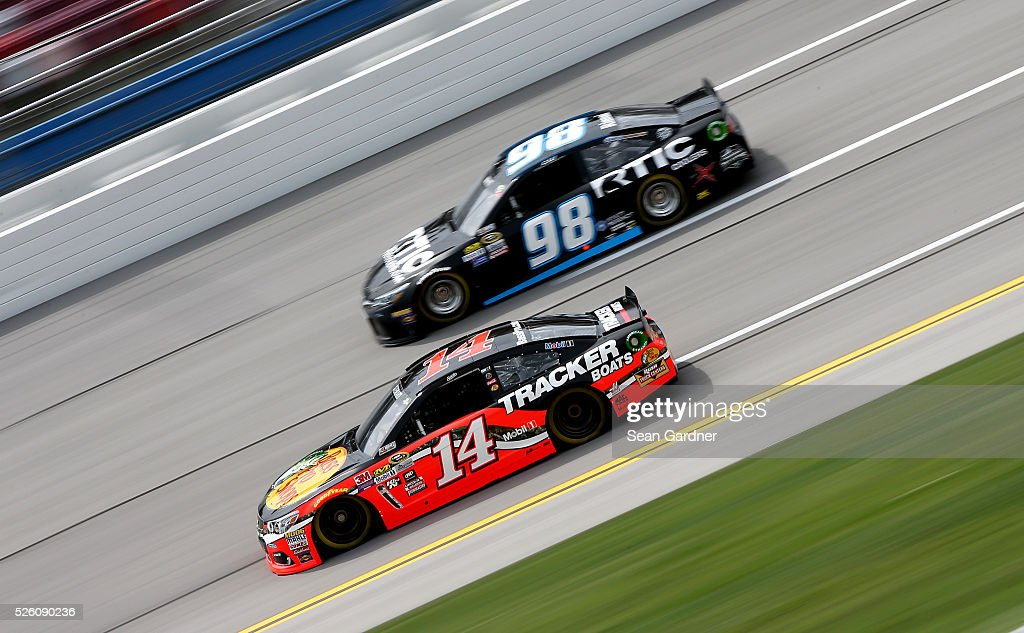 <a gi-track='captionPersonalityLinkClicked' href=/galleries/search?phrase=Tony+Stewart+-+Race+Car+Driver&family=editorial&specificpeople=201686 ng-click='$event.stopPropagation()'>Tony Stewart</a>, driver of the #14 Bass Pro Shops Chevrolet, and <a gi-track='captionPersonalityLinkClicked' href=/galleries/search?phrase=Cole+Whitt&family=editorial&specificpeople=7046334 ng-click='$event.stopPropagation()'>Cole Whitt</a>, driver of the #98 RticCoolers.com Chevrolet, practice for the NASCAR Sprint Cup Series GEICO 500 at Talladega Superspeedway on April 29, 2016 in Talladega, Alabama.