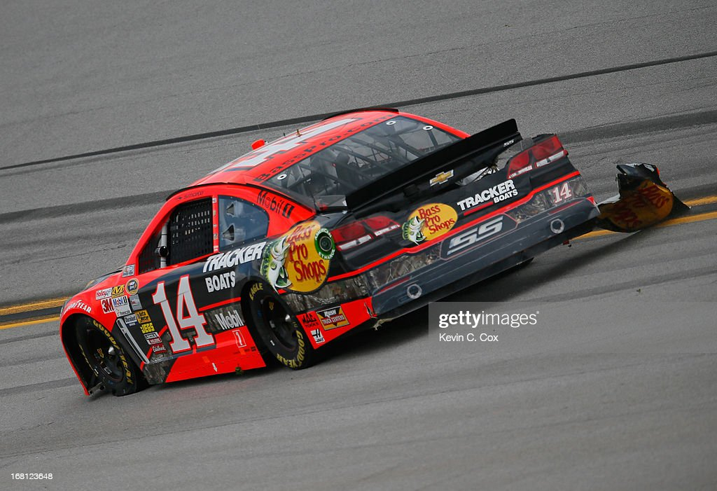 Tony Stewart, driver of the #14 Bass Pro Shops Chevrolet, drives down the backstretch after being involved in a wreck between turn one and two during the NASCAR Sprint Cup Series Aaron's 499 at Talladega Superspeedway on May 5, 2013 in Talladega, Alabama.