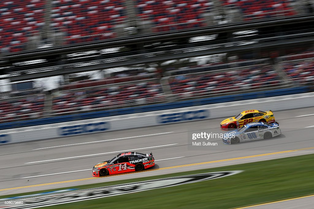 Tony Stewart, driver of the #14 Bass Pro Shops Chevrolet, leads Dale Earnhardt Jr, driver of the #88 Nationwide Chevrolet, and Joey Logano, driver of the #22 Shell Pennzoil Ford, during practice for the NASCAR Sprint Cup Series GEICO 500 at Talladega Superspeedway on April 29, 2016 in Talladega, Alabama.