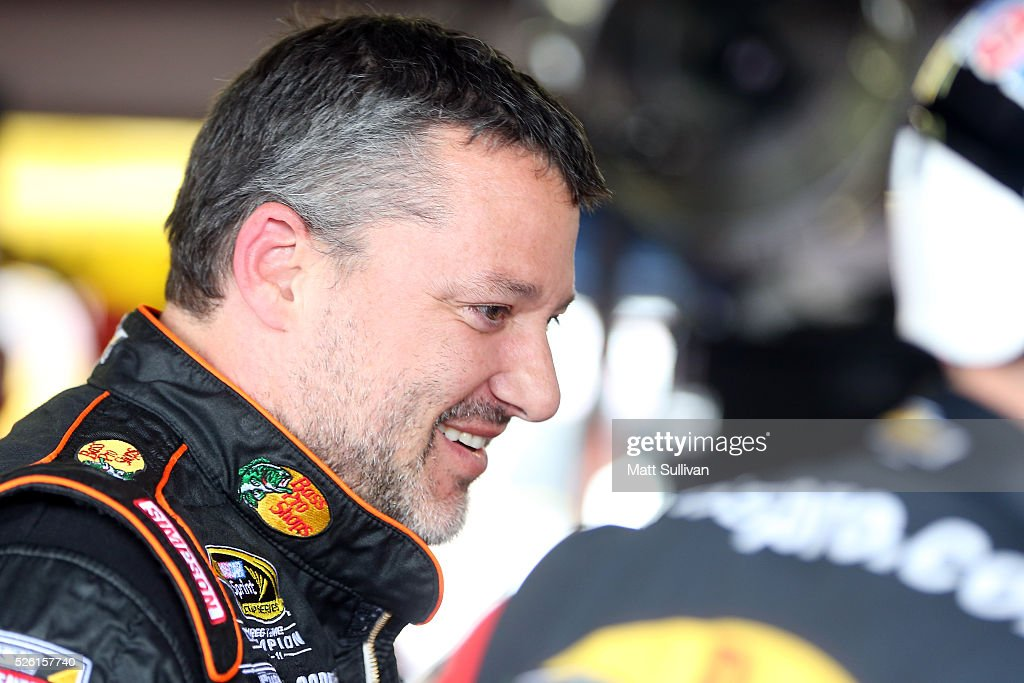 <a gi-track='captionPersonalityLinkClicked' href=/galleries/search?phrase=Tony+Stewart+-+Autocoureur&family=editorial&specificpeople=201686 ng-click='$event.stopPropagation()'>Tony Stewart</a>, driver of the #14 Bass Pro Shops Chevrolet, stands in the garage area during practice for the NASCAR Sprint Cup Series GEICO 500 at Talladega Superspeedway on April 29, 2016 in Talladega, Alabama.