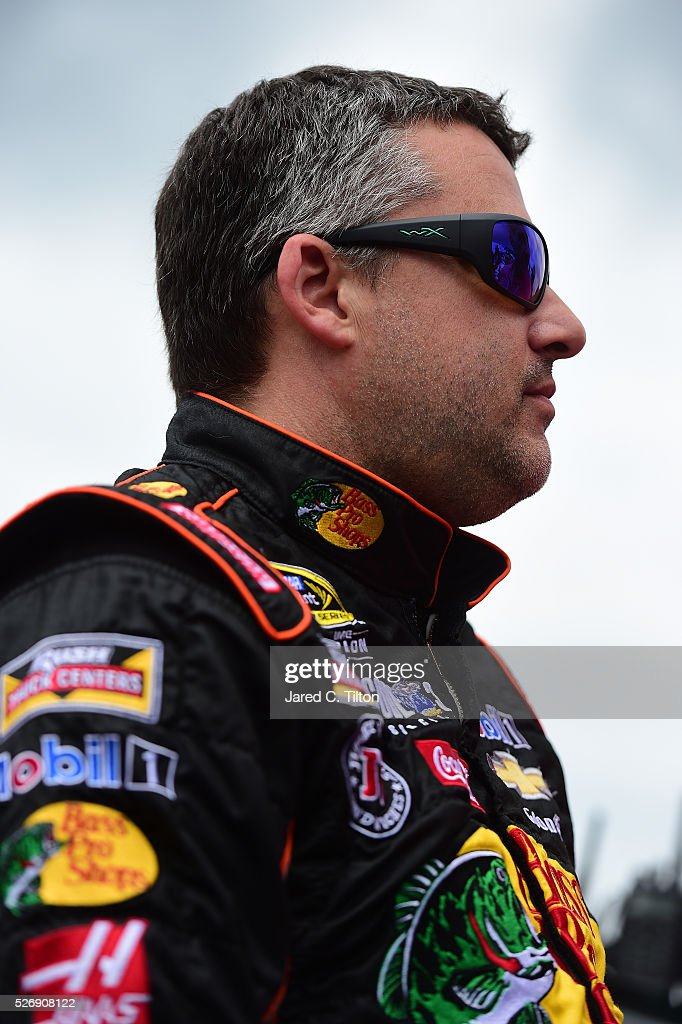 <a gi-track='captionPersonalityLinkClicked' href=/galleries/search?phrase=Tony+Stewart+-+Race+Car+Driver&family=editorial&specificpeople=201686 ng-click='$event.stopPropagation()'>Tony Stewart</a>, driver of the #14 Bass Pro Shops Chevrolet, stands on the grid prior to during the NASCAR Sprint Cup Series GEICO 500 at Talladega Superspeedway on May 1, 2016 in Talladega, Alabama.
