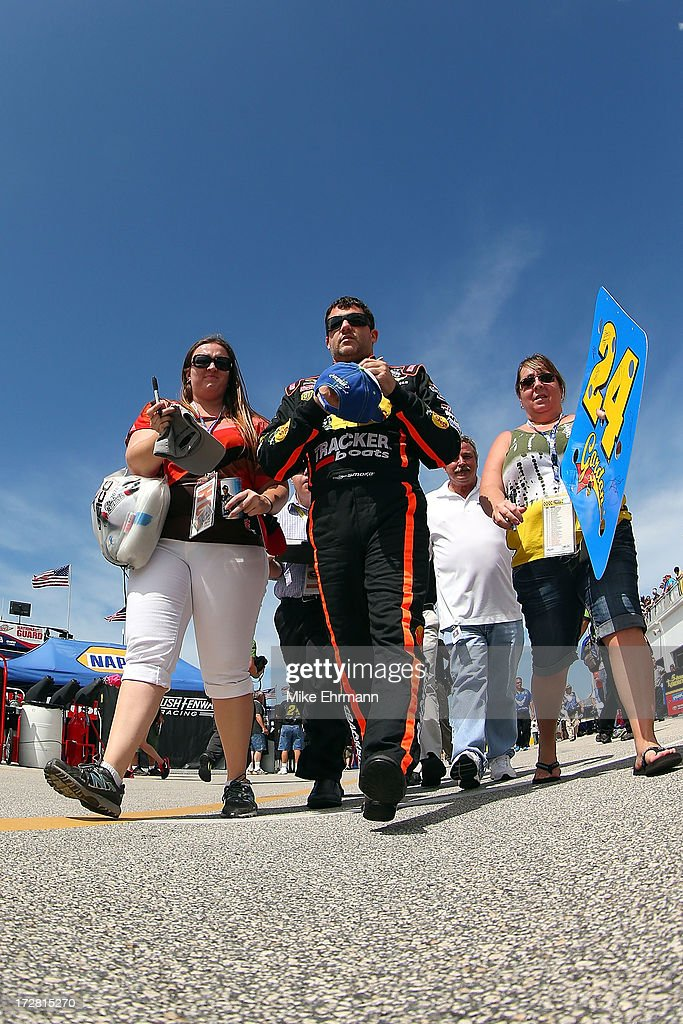 <a gi-track='captionPersonalityLinkClicked' href=/galleries/search?phrase=Tony+Stewart+-+Racerf%C3%B6rare&family=editorial&specificpeople=201686 ng-click='$event.stopPropagation()'>Tony Stewart</a>, driver of the #14 Bass Pro Shops / Ducks Unlimited Chevrolet, signs autographs in the garage area during practice for the NASCAR Sprint Cup Series Coke Zero 400 at Daytona International Speedway on July 4, 2013 in Daytona Beach, Florida.