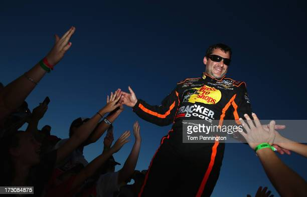 Tony Stewart driver of the Bass Pro Shops / Ducks Unlimited Chevrolet greets fans during driver introductions during the NASCAR Sprint Cup Series...