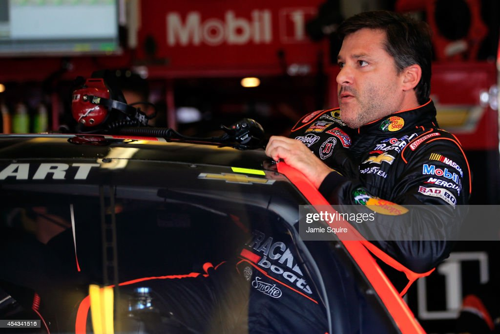 <a gi-track='captionPersonalityLinkClicked' href=/galleries/search?phrase=Tony+Stewart+-+Race+Car+Driver&family=editorial&specificpeople=201686 ng-click='$event.stopPropagation()'>Tony Stewart</a>, driver of the #14 Bass Pro Shops / Mobil 1 Chevrolet, climbs into his car prior to practice for the NASCAR Sprint Cup Series Oral-B USA 500 at Atlanta Motor Speedway on August 29, 2014 in Hampton, Georgia. This marks Stewart's first race since he hit and killed sprint car driver Kevin Ward Jr. during a dirt track race August 9, after Ward Jr. had exited his car.