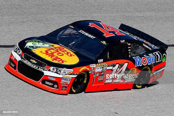 Tony Stewart driver of the Bass Pro Shops / Mobil 1 Chevrolet drives during practice for the NASCAR Sprint Cup Series Folds of Honor QuikTrip 500 at...