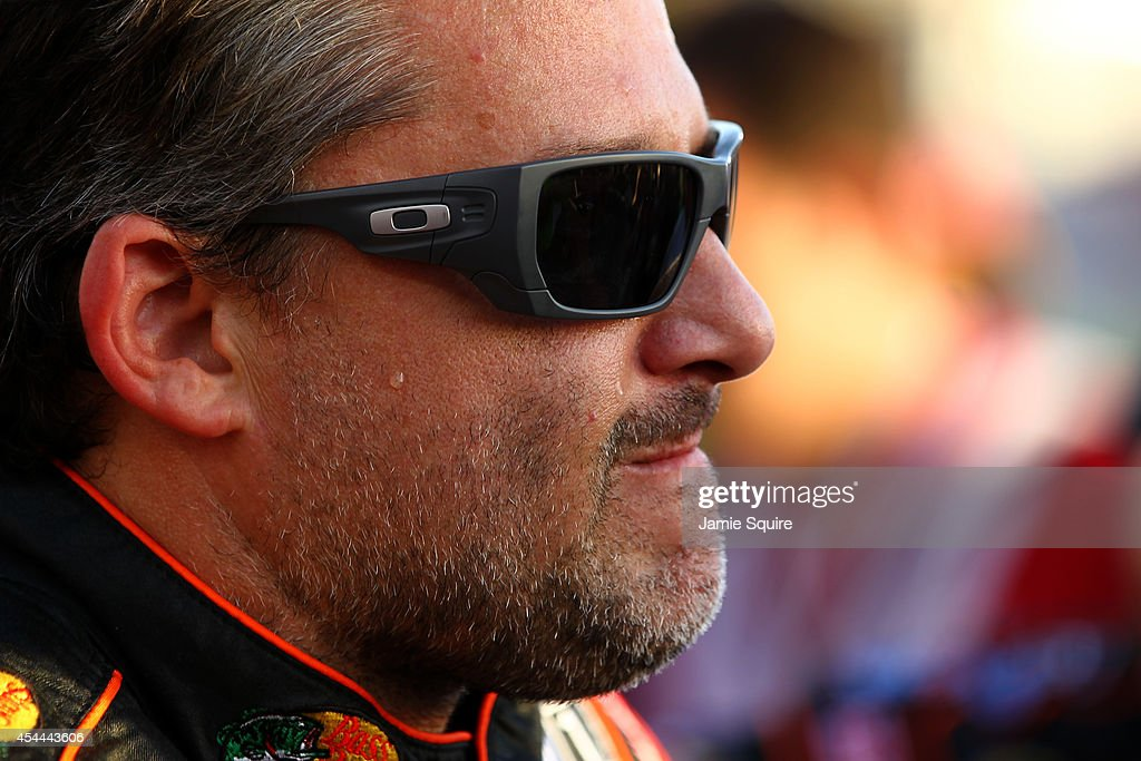 <a gi-track='captionPersonalityLinkClicked' href=/galleries/search?phrase=Tony+Stewart+-+Race+Car+Driver&family=editorial&specificpeople=201686 ng-click='$event.stopPropagation()'>Tony Stewart</a>, driver of the #14 Bass Pro Shops / Mobil 1 Chevrolet, looks on prior to the NASCAR Sprint Cup Series Oral-B USA 500 at Atlanta Motor Speedway on August 31, 2014 in Hampton, Georgia.