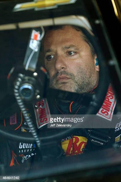 Tony Stewart driver of the Bass Pro Shops / Mobil 1 Chevrolet prepares to drive during practice for the NASCAR Sprint Cup Series Folds of Honor...