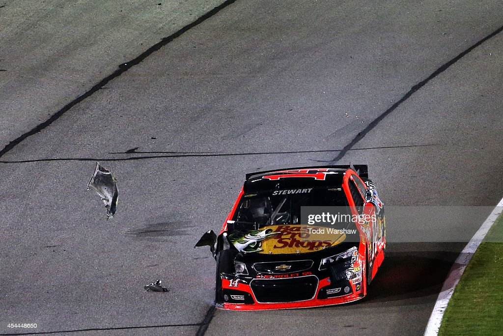 <a gi-track='captionPersonalityLinkClicked' href=/galleries/search?phrase=Tony+Stewart+-+Race+Car+Driver&family=editorial&specificpeople=201686 ng-click='$event.stopPropagation()'>Tony Stewart</a>, driver of the #14 Bass Pro Shops / Mobil 1 Chevrolet, sheds debree on the race track after being involved in an on-track incident during the NASCAR Sprint Cup Series Oral-B USA 500 at Atlanta Motor Speedway on August 31, 2014 in Hampton, Georgia.
