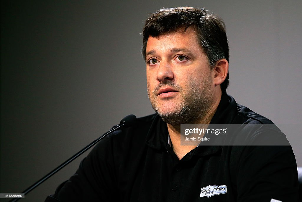 <a gi-track='captionPersonalityLinkClicked' href=/galleries/search?phrase=Tony+Stewart+-+Race+Car+Driver&family=editorial&specificpeople=201686 ng-click='$event.stopPropagation()'>Tony Stewart</a>, driver of the #14 Bass Pro Shops / Mobil 1 Chevrolet, speaks to the media prior to practice for the NASCAR Sprint Cup Series Oral-B USA 500 at Atlanta Motor Speedway on August 29, 2014 in Hampton, Georgia. Stewart hit and killed sprint car driver Kevin Ward Jr. during a dirt track race August 9, after Ward Jr. had exited his car.
