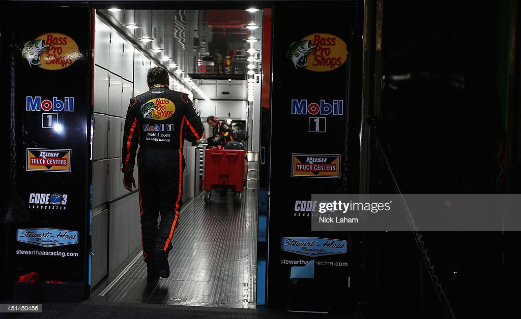 <a gi-track='captionPersonalityLinkClicked' href=/galleries/search?phrase=Tony+Stewart+-+Race+Car+Driver&family=editorial&specificpeople=201686 ng-click='$event.stopPropagation()'>Tony Stewart</a>, driver of the #14 Bass Pro Shops / Mobil 1 Chevrolet, walks into his hauler after an on track incident during the NASCAR Sprint Cup Series Oral-B USA 500 at Atlanta Motor Speedway on August 31, 2014 in Hampton, Georgia.