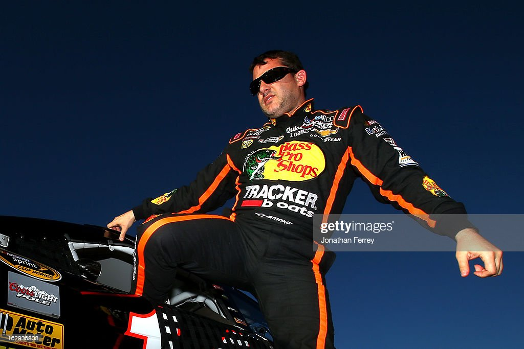 Tony Stewart, driver of the #14 Bass Pro Shops/Mobil 1 Chevrolet, gets into his car during qualifying for the NASCAR Sprint Cup Series Subway Fresh Fit 500 at Phoenix International Raceway on March 1, 2013 in Avondale, Arizona.
