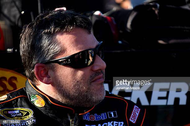 Tony Stewart driver of the Bass Pro Shops/Mobil 1 Chevrolet looks on during qualifying for the NASCAR Sprint Cup Series Federated Auto Parts 400 at...