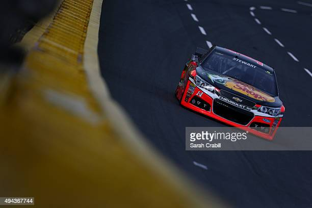 Tony Stewart driver of the Bass Pro Shops/Mobil 1 Chevrolet practices for the NASCAR Sprint Cup Series Bank of America 500 at Charlotte Motor...