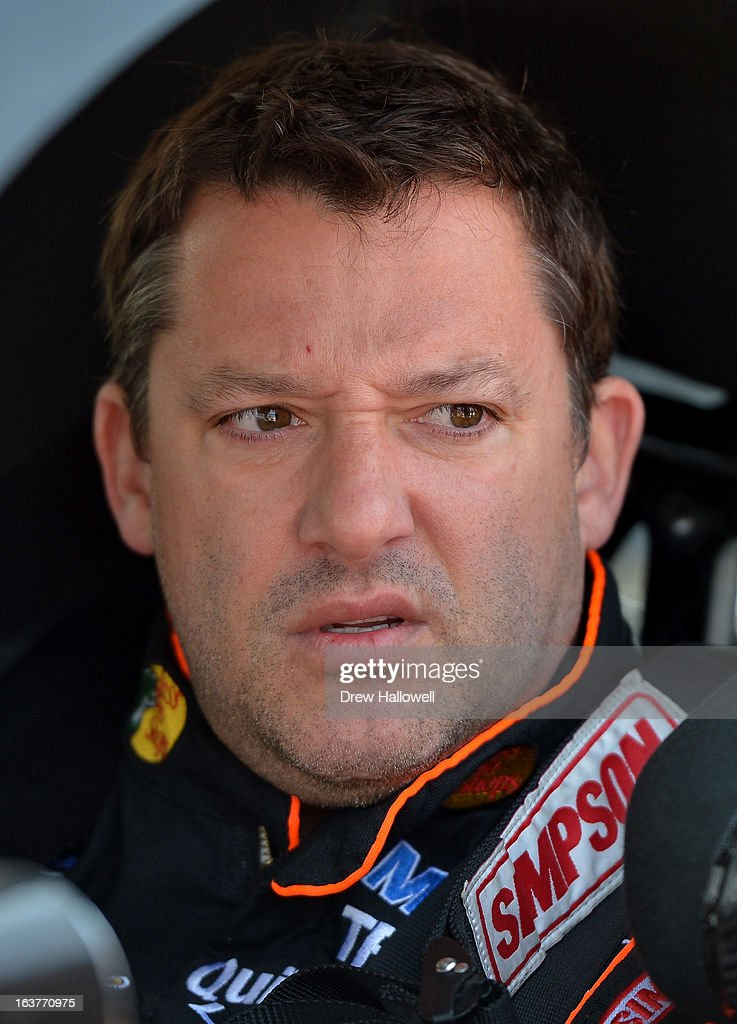 <a gi-track='captionPersonalityLinkClicked' href=/galleries/search?phrase=Tony+Stewart+-+Racerf%C3%B6rare&family=editorial&specificpeople=201686 ng-click='$event.stopPropagation()'>Tony Stewart</a>, driver of the #14 Bass Pro Shops/Mobil 1 Chevrolet, sits in his car during practice for the NASCAR Sprint Cup Series Food City 500 at Bristol Motor Speedway on March 15, 2013 in Bristol, Tennessee.