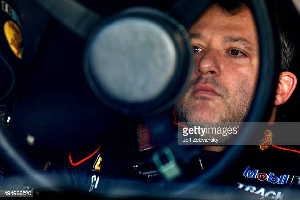 Tony Stewart driver of the Bass Pro Shops/Mobil 1 Chevrolet sits in his car in the garage area during practice for the NASCAR Sprint Cup Series...
