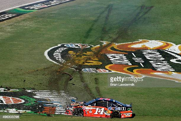 Tony Stewart driver of the Bass Pro Shops/Mobil 1 Chevrolet spins during the NASCAR Sprint Cup Series AAA Texas 500 at Texas Motor Speedway on...