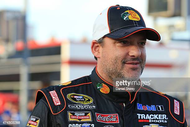 Tony Stewart driver of the Bass Pro Shops/Mobil 1 Chevrolet walks on the grid prior to qualifying for the NASCAR Sprint Cup Series CocaCola 600 at...