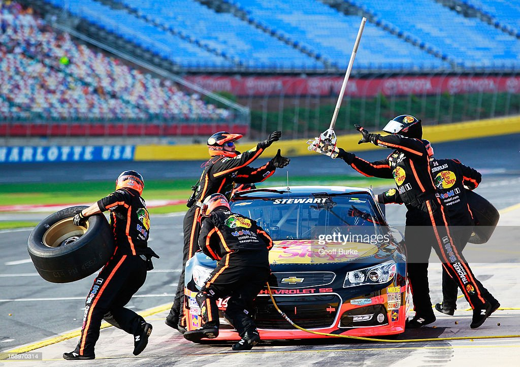<a gi-track='captionPersonalityLinkClicked' href=/galleries/search?phrase=Tony+Stewart+-+Race+Car+Driver&family=editorial&specificpeople=201686 ng-click='$event.stopPropagation()'>Tony Stewart</a>, driver of the #14 Bass Pro Shops/NWTF Chevrolet, pits during qualifying for the NASCAR Sprint Cup Series All-Star Race at Charlotte Motor Speedway on May 17, 2013 in Concord, North Carolina.
