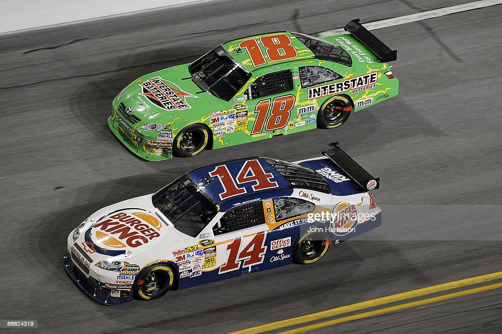 Tony Stewart, driver of the #14 Burger King Chevrolet, leads Kyle Busch, driver of the #18 Interstate Battereis Toyota, during the NASCAR Sprint Cup Series 51st Annual Coke Zero 400 at Daytona International Speedway on July 4, 2009 in Daytona Beach, Florida.
