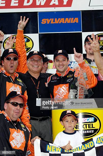 Tony Stewart driver of the Chevrole celebrates winning the NASCAR Nextel Cup Series New England 300 on July 17 2005 at New Hampshire International...