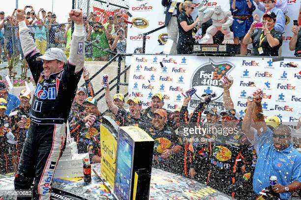 Tony Stewart driver of the Code 3 Associates/Mobil 1 Chevrolet celebrates in Victory Lane after winning the NASCAR Sprint Cup Series FedEx 400...