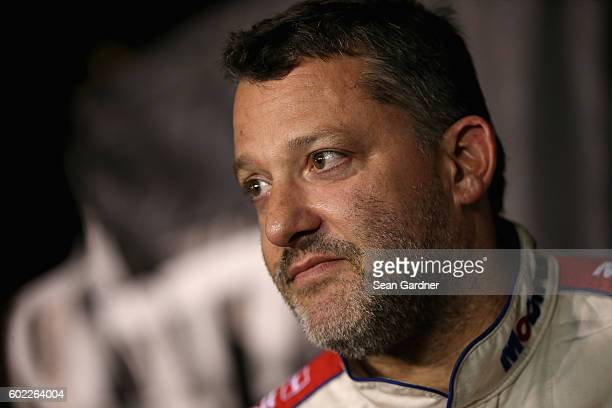 Tony Stewart driver of the Code 3 Associates/Mobil 1 Chevrolet reacts after the NASCAR Sprint Cup Series Federated Auto Parts 400 at Richmond...