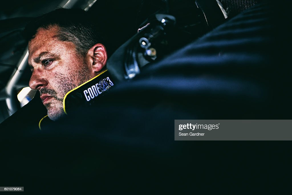 Tony Stewart, driver of the #14 Code 3 Associates/Mobil 1 Chevrolet, sits in his car during practice for the NASCAR Sprint Cup Series Federated Auto Parts 400 at Richmond International Raceway on September 9, 2016 in Richmond, Virginia.