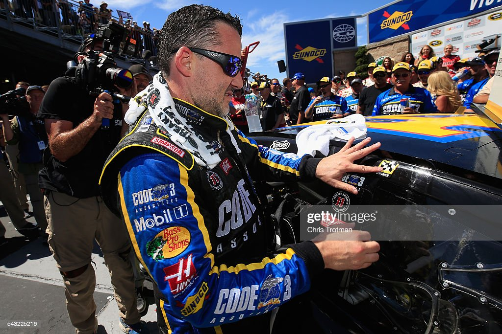 <a gi-track='captionPersonalityLinkClicked' href=/galleries/search?phrase=Tony+Stewart+-+Race+Car+Driver&family=editorial&specificpeople=201686 ng-click='$event.stopPropagation()'>Tony Stewart</a>, driver of the #14 Code 3 Assoc/Mobil 1 Chevrolet, applies a Winner Sticker in victory lane after winning the NASCAR Sprint Cup Series Toyota/Save Mart 350 at Sonoma Raceway on June 26, 2016 in Sonoma, California.