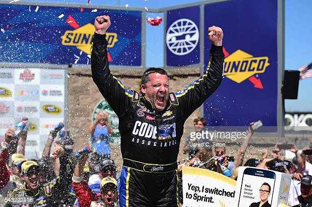 Tony Stewart driver of the Code 3 Assoc/Mobil 1 Chevrolet celebrates in victory lane after winning the NASCAR Sprint Cup Series Toyota/Save Mart 350...